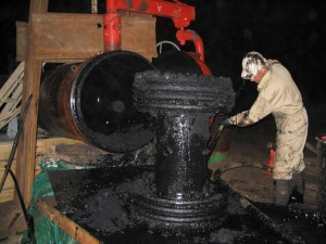 Inline pigging expert uses mandrel pig to remove black powder from pipeline.